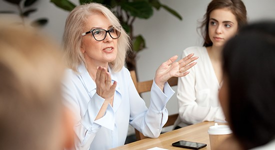 Business woman talking to group