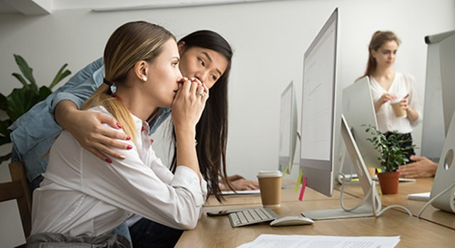 Woman comforts upset co-worker
