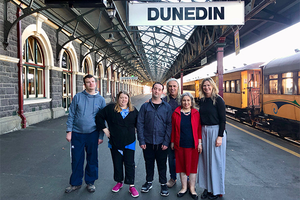 Photo of group from Donald Beasley Institute at Dunedin Train Station