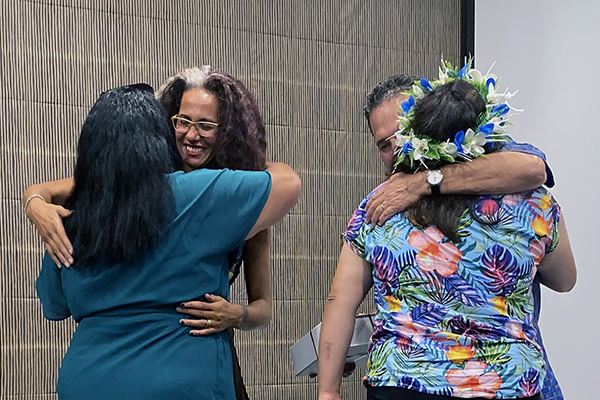 photo of pacifika staff hugging