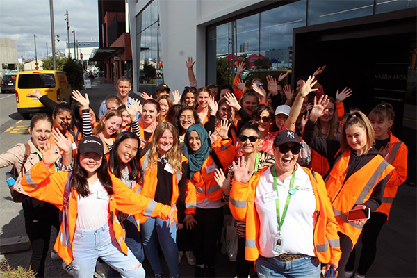 photo of young women in high-vis jackets