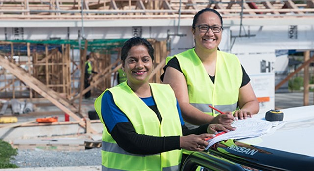 Two women working on a building site